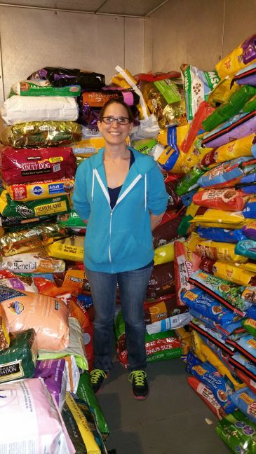 Lori, FP2 volunteer, with donated food